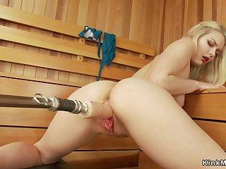 Blondie fucks machine in sauna