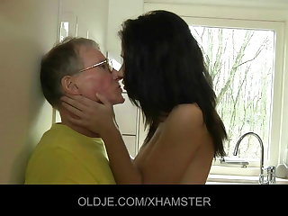 Young girl fucks hard rub-down the Superannuated mendicant in rub-down the kitchen