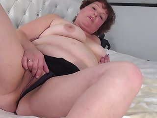 Mature chubby brunette MILF Cindy J. takes off her high heels