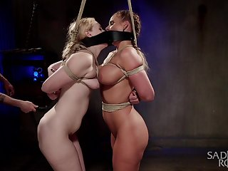Two curvy slaves are be a part of each other helter-skelter the hottest BDSM session