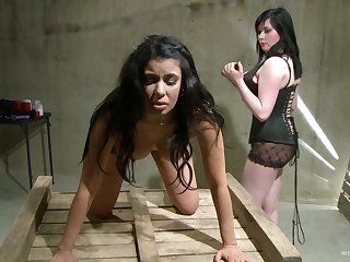 Butch femdom talisman scene with teen brunette babes in a donjon